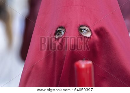 Detail Penitent Red Holding A Candle During Holy Week, Spain
