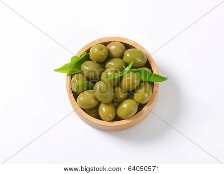 overhead view of pickled olives served in the wooden bowl