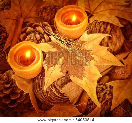 Thanksgiving day decoration, beautiful natural decor for autumnal holiday, old dry maple leaves, pine cones, warm candle light