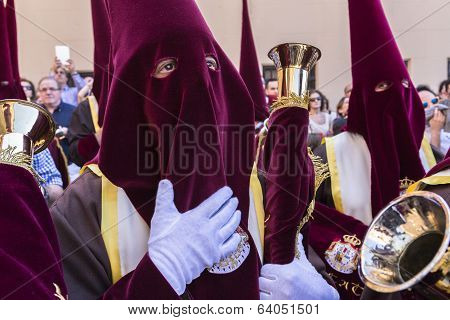 Nazarenes With Red Tunics And Trumpets In The Hands Of Penance During Station, Taken In Linares, Jae