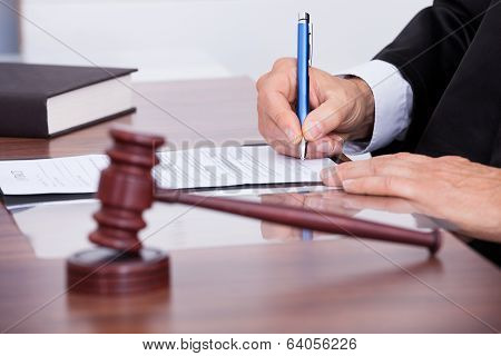 Male Judge Writing On Paper