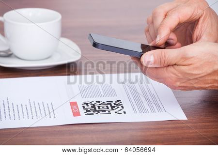 Person Scanning Barcode Using Cellphone