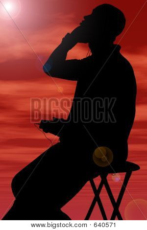 Silhouette With Clipping Path Of Man Listening To Headphones Aga