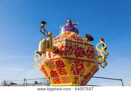 Russia, Samara - March 2, 2014: Shrovetide In Russia. Big Improvised Samovar Over Blue Sky. Maslenit