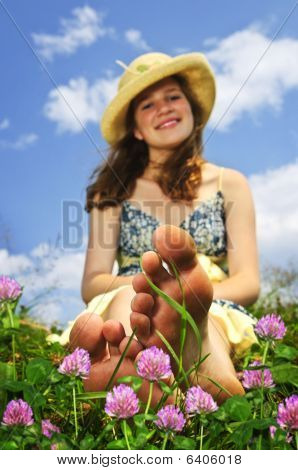 Young Girl Sitting On Meadow