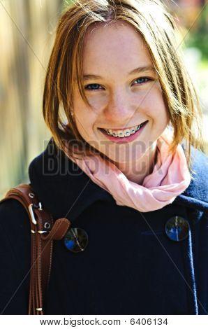 Happy Teenage Girl In Coat