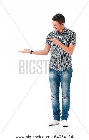 Successful young man in shirt showing something, isolated on white background