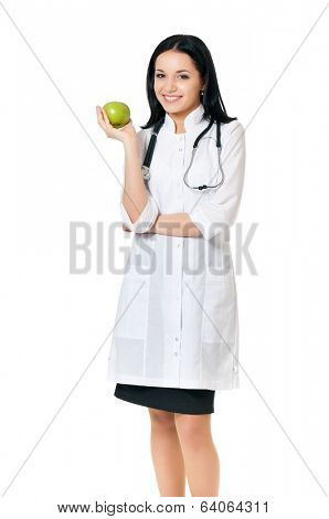 Young female doctor with green apple, isolated on white background