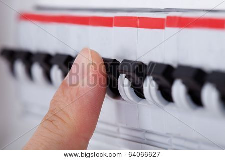 Human Hand On Distribution Board