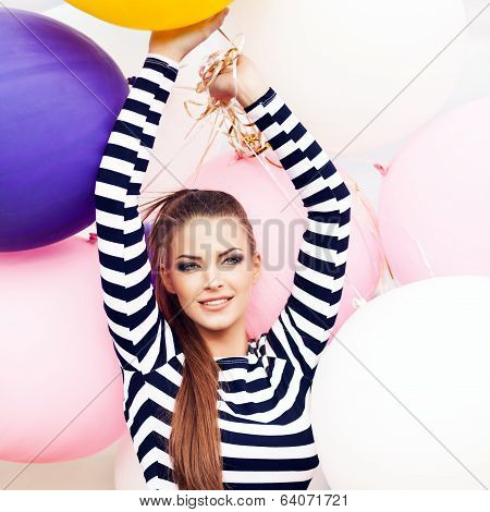 Beautiful Lady In Short Black And White Striped Dress Holds Bunch Of Multicolored Balloons