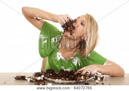 Woman Green Shirt With Cake Elbow Up Stuff In Mouth