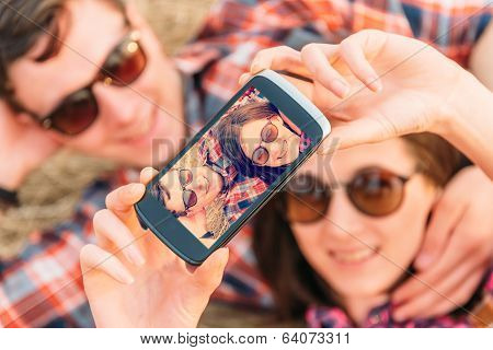 Happy Couple Takes Photographs Self Portrait
