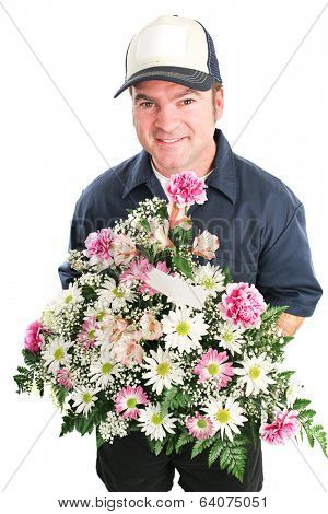 Delivery man delivers a bouquet of flowers for Mother's Day, birthday, or other special occasion.  Isolated on white.