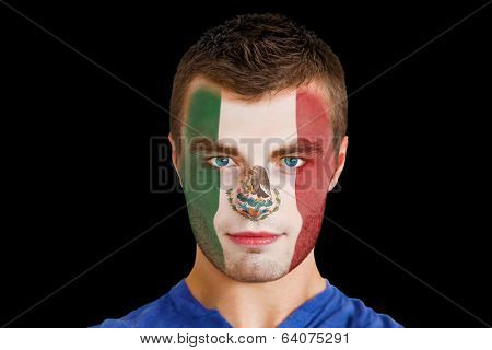 Composite image of serious young mexico fan with facepaint against black