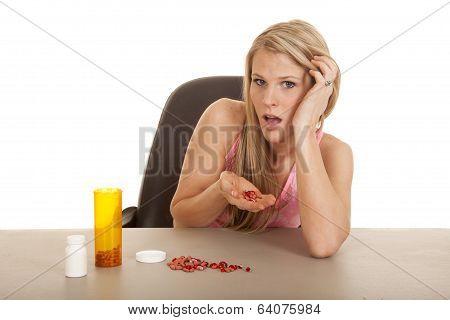 Woman Pink Tankk Top Pills In Hand