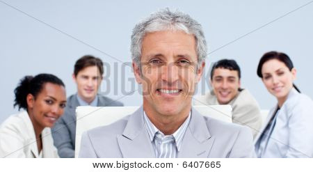 Portrait Of A Mature Businessman Smiling In A Meeting