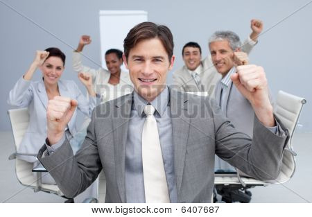 Happy Business Team Celebrating A Sucess With Hands Up