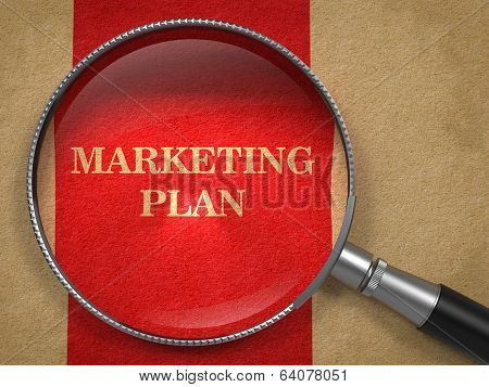Marketing Plan. Magnifying Glass on Old Paper.