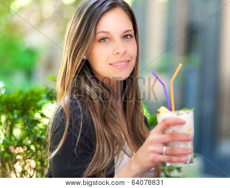 Beautiful woman having an aperitif outdoor
