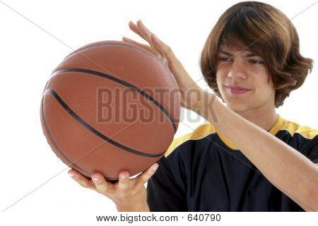 Teen Boy Holding Basket Ball Over White