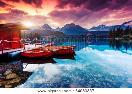 Peaceful mountain lake in National Park High Tatra. Dramatic overcast sky. Strbske pleso, Slovakia, Europe. Beauty world.