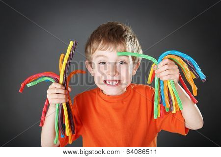 Young boy holding colorful licorice candy