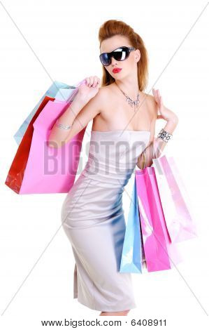 Stylishly Dressed Young Girl With Purchases In Hands