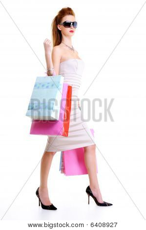 Glamour Young Girl With Shopping Bags