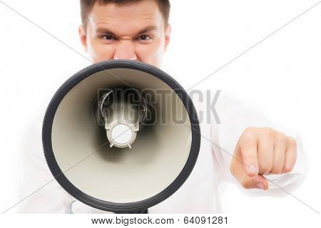 Angry businessman boss screaming isolated on white. Focus on megaphone.