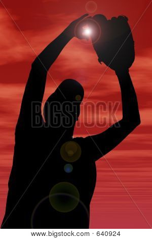 Silhouette With Clipping Path Of Female Softball Player Against