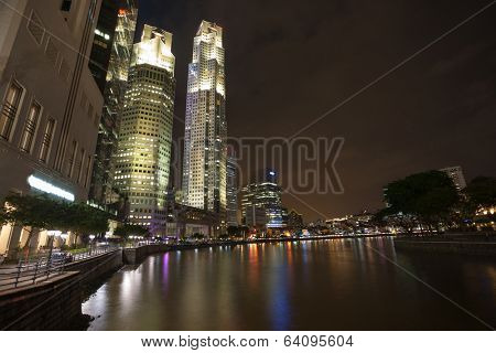 Boat Quay in Singapore overlooking the Central Business District in the evening.