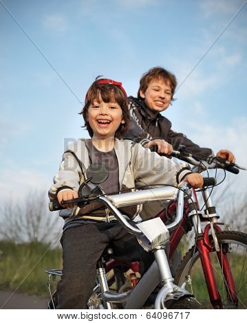 two brothers ride bikes