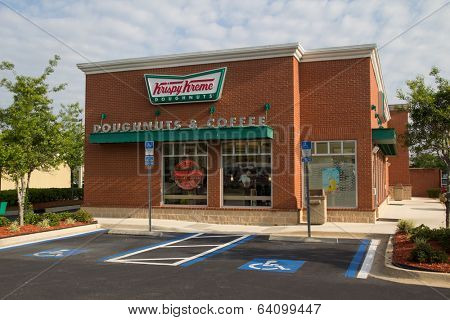 JACKSONVILLE, FL - APRIL 27, 2014: A Krispy Kreme Doughnuts store in Jacksonville. Krispy Kreme was founded on July 13, 1937 by founder Vernon Rudolph.
