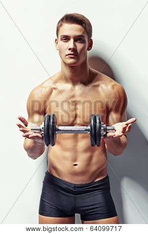 Young Bodybuilder Man Offering Dumbbell
