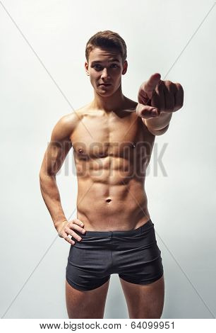 Muscular Man In Underwear Pointing Forward