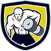 picture of strongman  - Illustration of a strongman muscular guy lifting dumbbells weight training viewed from front set inside shield crest shape done in retro style - JPG