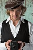 foto of beret  - Handsome caucasian male photographer wearing a vintage formal jacket white shirt and checkered beret - JPG