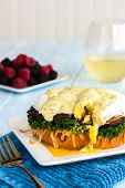 stock photo of benediction  - Vegetarian eggs benedict made with gouda cheese steamed kale sauteed portobello mushroom - JPG