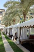 Luxurious Hotel Recreation Area With Huts And Palm Trees, Dubai, Uae poster