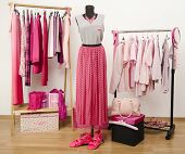 stock photo of mannequin  - Wardrobe full of all shades of pink clothes - JPG