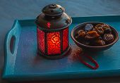 stock photo of nomads  - Ramadan lamp and dates on a wooden tray - JPG