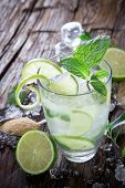 stock photo of mojito  - Fresh mojito drink on wooden table - JPG