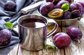 stock photo of plum fruit  - Fresh plum juice and fruits with leaves