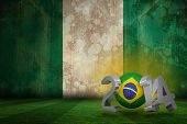 stock photo of nigeria  - Brazil 2014 against nigeria flag in grunge effect - JPG