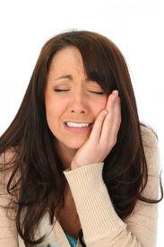stock photo of sad face  - Closeup of a beautiful brunette woman crying - JPG