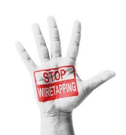 stock photo of wiretap  - Open hand raised Stop Wiretapping sign painted multi purpose concept  - JPG
