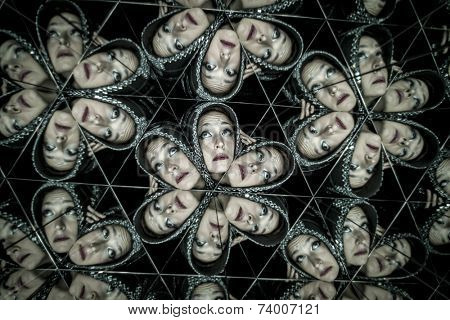 Attractive, woman with helmet in a kaleidoscope of mirrors