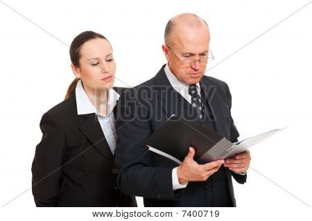 Businesswoman Furtively Looking At Documents