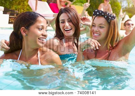 Three Women Having Fun In Swimming Pool