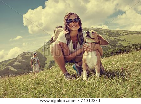 Woman With Beagle On Mountain Hill